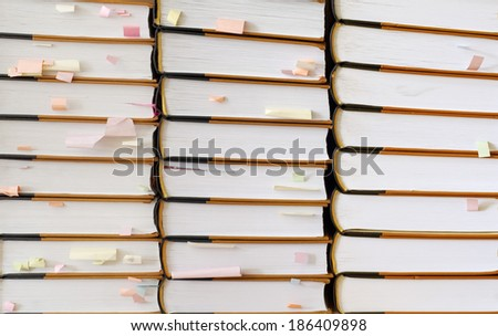 stack of books with color sticky notes - stock photo