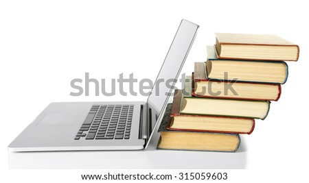 Stack of books with laptop isolated on white