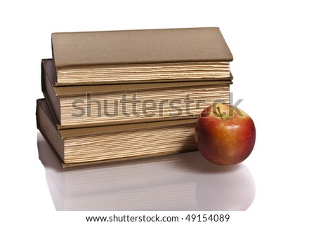 stack of books with reflection with apple