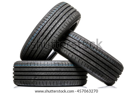 Stack of brand new high performance car tires on clean high-key white studio background - stock photo