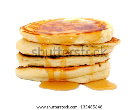 Stack of breakfast pancakes with dripping syrup isolated on white - stock photo