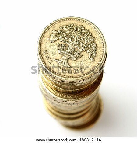 Stack of British Pound Coins on a plain white background - stock photo