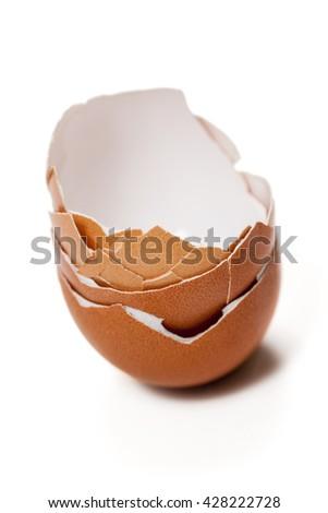 Stack of broken eggshells isolated on white - stock photo