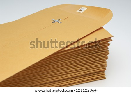 Stack of brown envelope with clipping over white background - stock photo