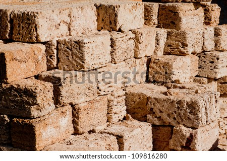 Stack of building materials such shell rock - stock photo
