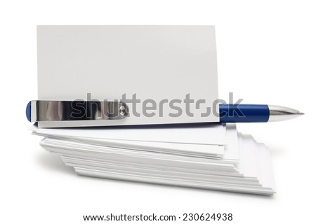 Stack of business cards and blue pen isolates on white