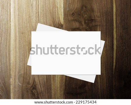 stack of business cards on wooden table, 3d render - stock photo