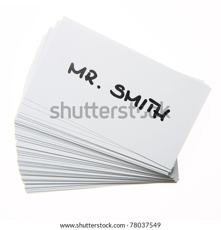 Stack of business cards with 'Mr. Smith' handwritten on the top one