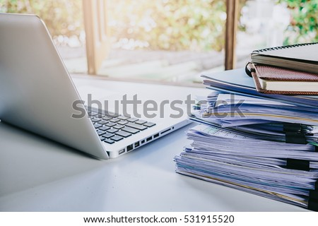 desk office file document paper. Stack Of Business Report Paper File On Modern White Office Desk With Laptop Computer.Close Document