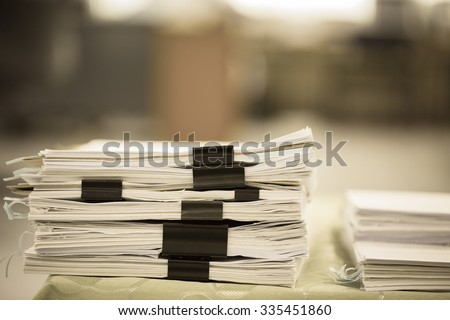 Stack of business report paper files with black clips   - stock photo