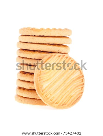 stack of butter cookies with one standing isolated on white background