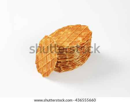stack of butter waffle cookies on white background