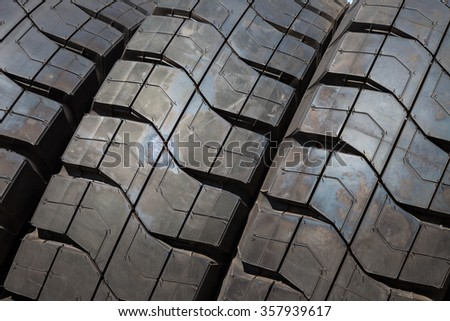 Stack of car tires close up wheel profile structure background. Background. Backgrounds. Texture