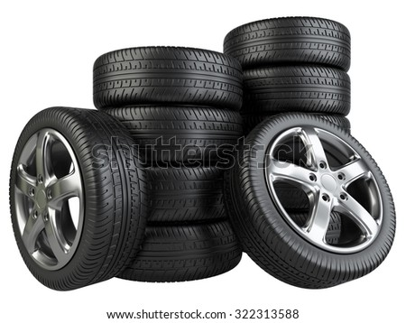 Stack of car wheels isolated on a white background - stock photo