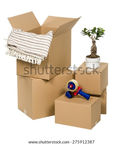 Stack of cardboard boxes isolated on white background with flower, tape and blanket