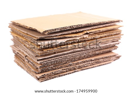 Stack of cardboard for recycling isolated on white - stock photo