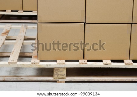 Stack of carton boxes package on pallet - stock photo