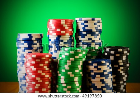 Stack of casino chips against gradient background - stock photo