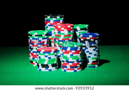 Stack of casion chips on table - stock photo
