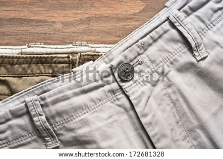 Stack of casual cotton men's trousers - stock photo
