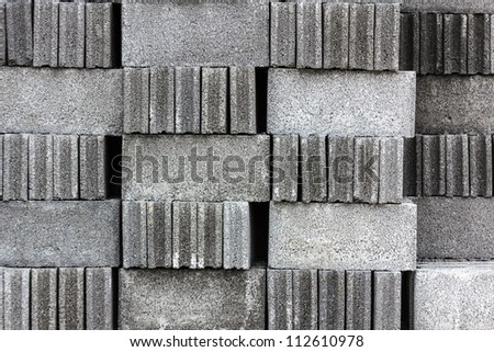 Stack of cement blocks at the construction site - stock photo