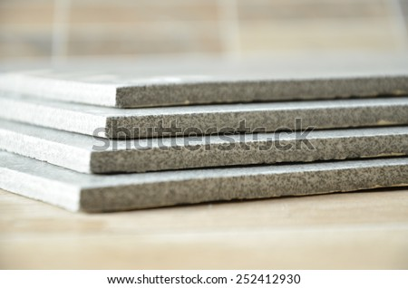 Stack of ceramic tiles, grey and modern - stock photo