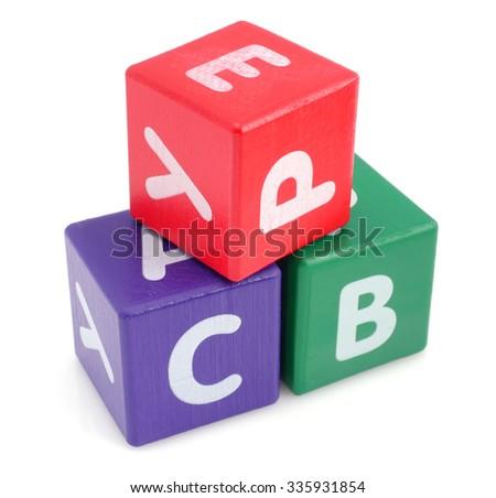 Stack of children's alphabet blocks.  - stock photo