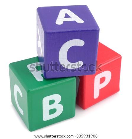 Stack of children's alphabet blocks  - stock photo