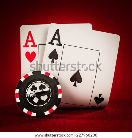 Stack of chips and two aces - stock photo
