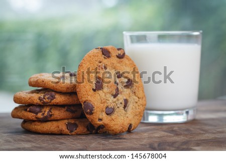 Stack of Chocolate chip cookie and glass of milk - stock photo