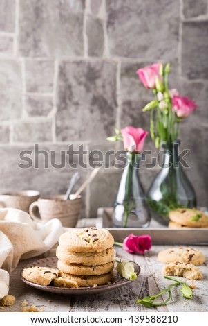 Stack of chocolate chip shortbread cookies on plate. Selective focus. - stock photo