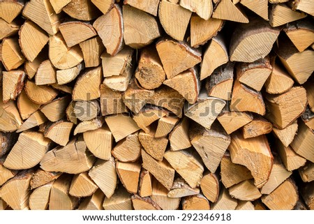 Stack of chopped fire wood for winter - stock photo