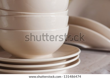 Stack of clean cookware in kitchen. - stock photo