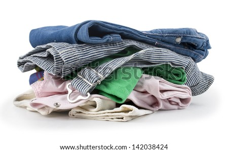 Stack of clothes isolated on white background - stock photo