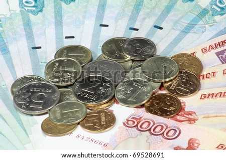 stack of coin and bond scattering - stock photo