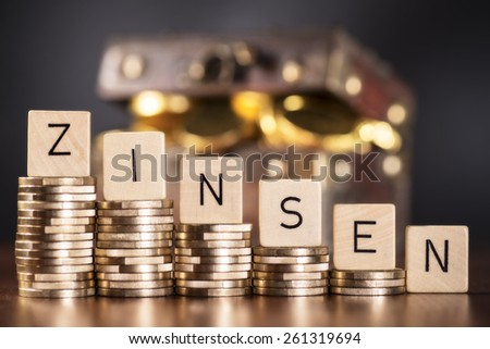 Stack of coins and the word interest.