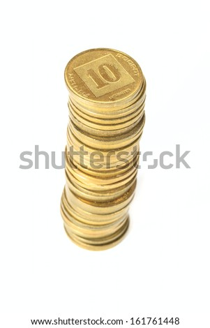 Stack of coins Israeli ten agorot in shallow DOF isolated on white background - stock photo