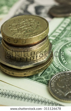 Stack of coins on money bank note