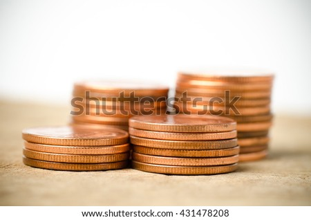 Stack of coins on wooden background,money concept