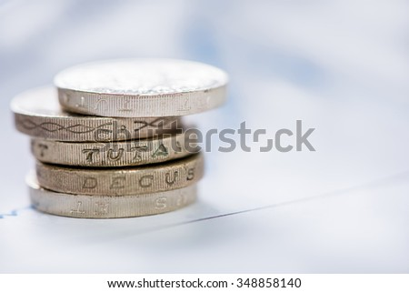 Stack of coins over blur background with copy space
