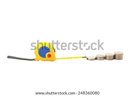 Stack of coins with tape measuring isolated on white. - stock photo