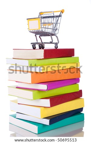 Stack of color books and a shopping cart (isolated on white) - stock photo