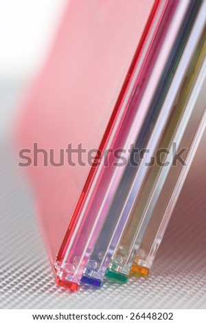 Stack of color cd boxes,shallow dof - stock photo