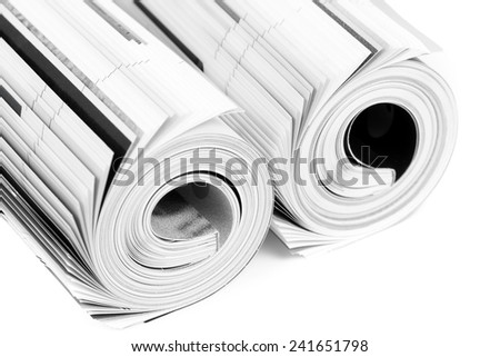 Stack of color magazines on white background