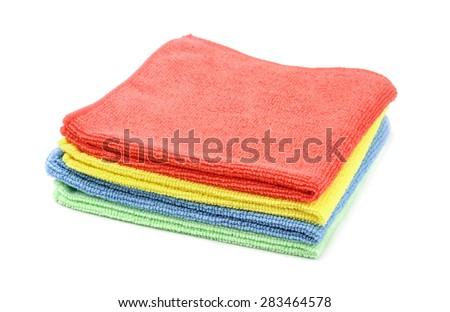 Stack of color microfiber cloths isolated on white - stock photo