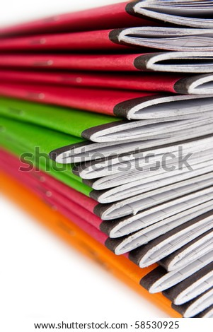Stack of color notebooks on white background