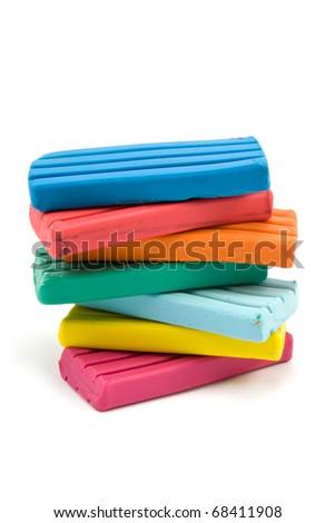 stack of color plasticine bricks on white background - stock photo