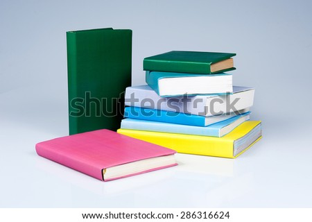 stack of colored books isolated on white