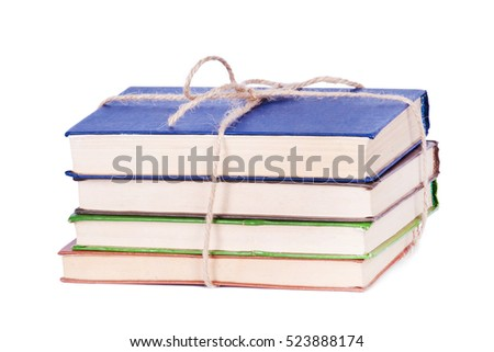 Stack of colored old books isolated on white background