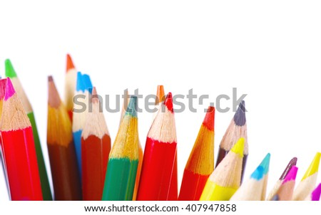 stack of colored pencils on white background